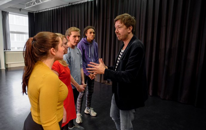 Docent in gesprek ivm audities
